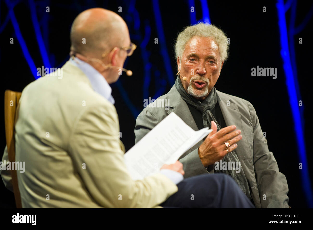 Tom Jones speaking on stage interviewed by Dylan Jones at Hay Festival 2016 - Stock Image