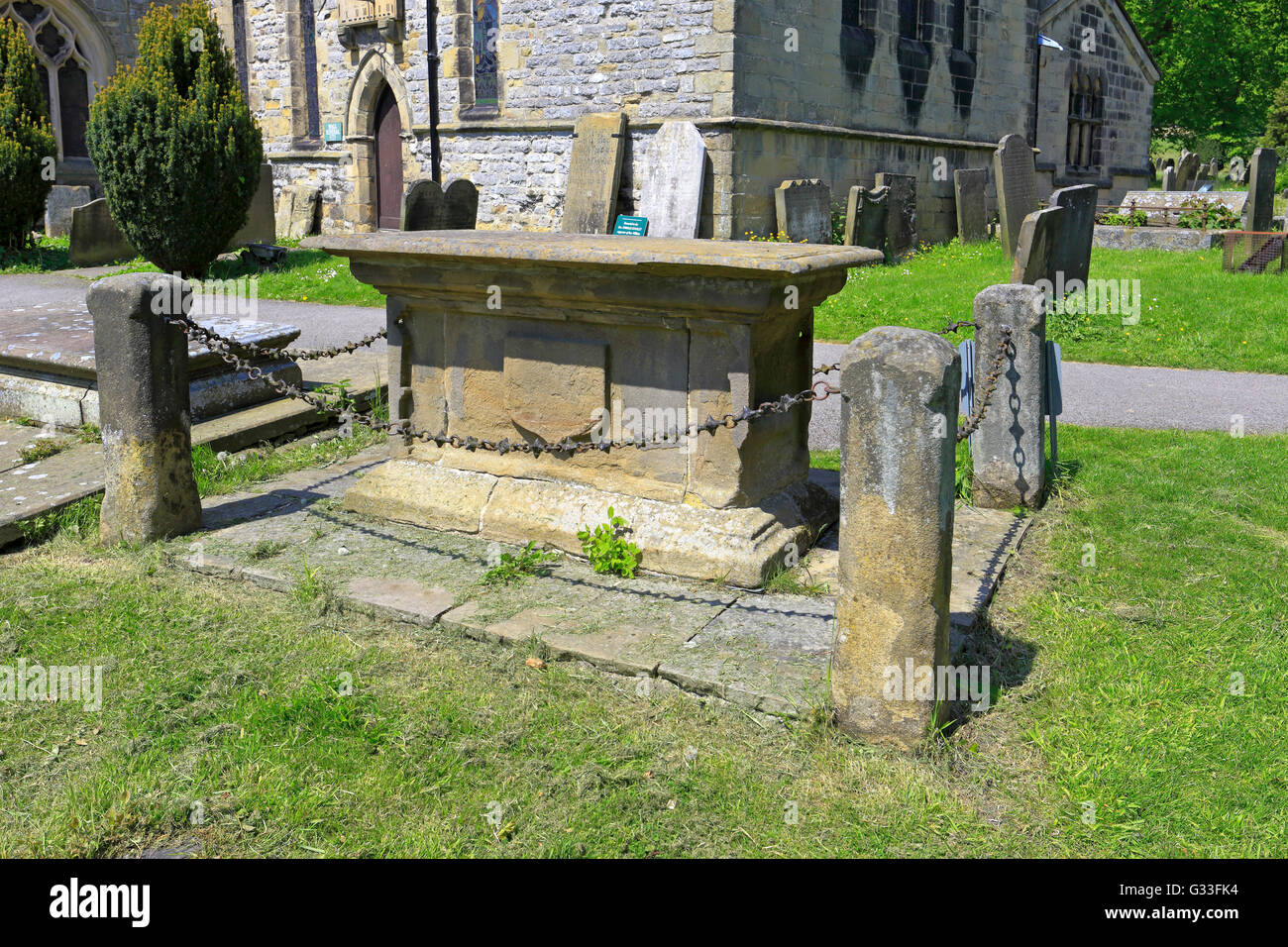 Tomb of Catherine Mompesson, St Lawrence's Church in the plague village of Eyam, Peak District National Park, - Stock Image