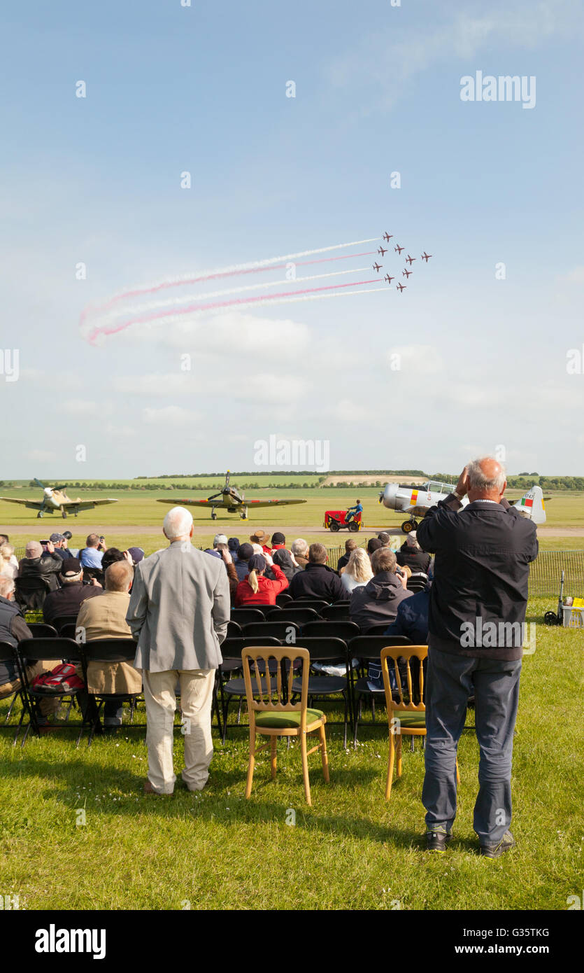 People watching the RAF Red Arrows performing, Duxford Airshow, UK - Stock Image