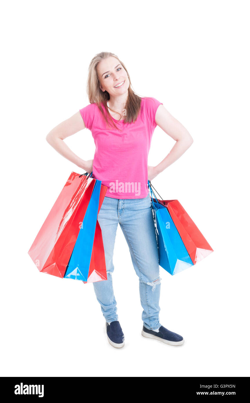 Happy girl holding colorful shopping bags and smiling as spree and leisure concept isolated on white - Stock Image
