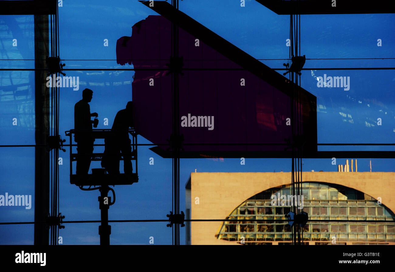 Workers Remove An Artwork On The Glass Facade Of Berlin Central