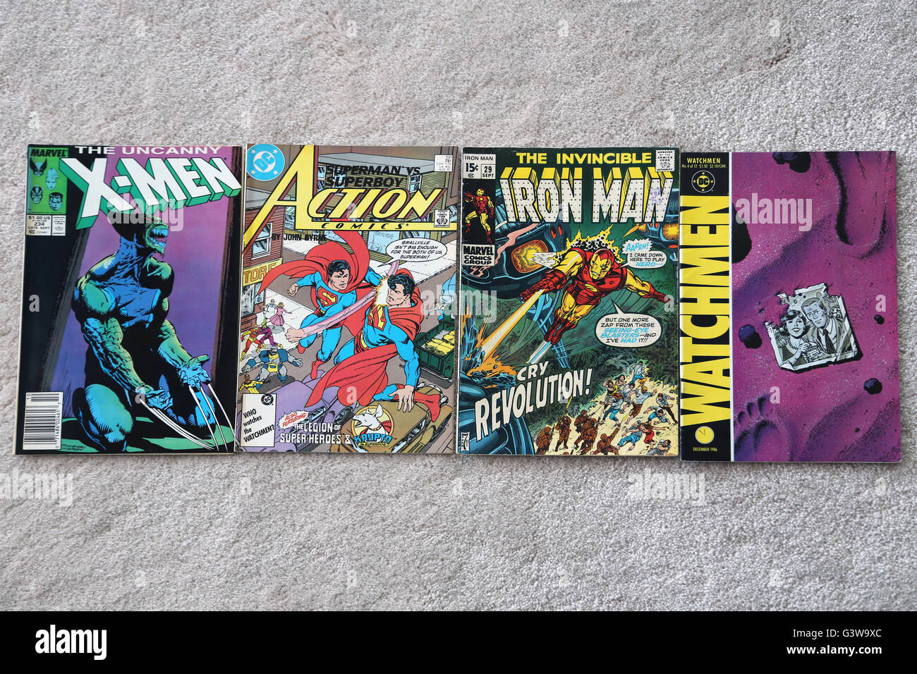 Collection Of Vintage Marvel And DC Comic Books The Uncanny X-Men, Action Comics Superman, The Invincible Iron Man Stock Photo
