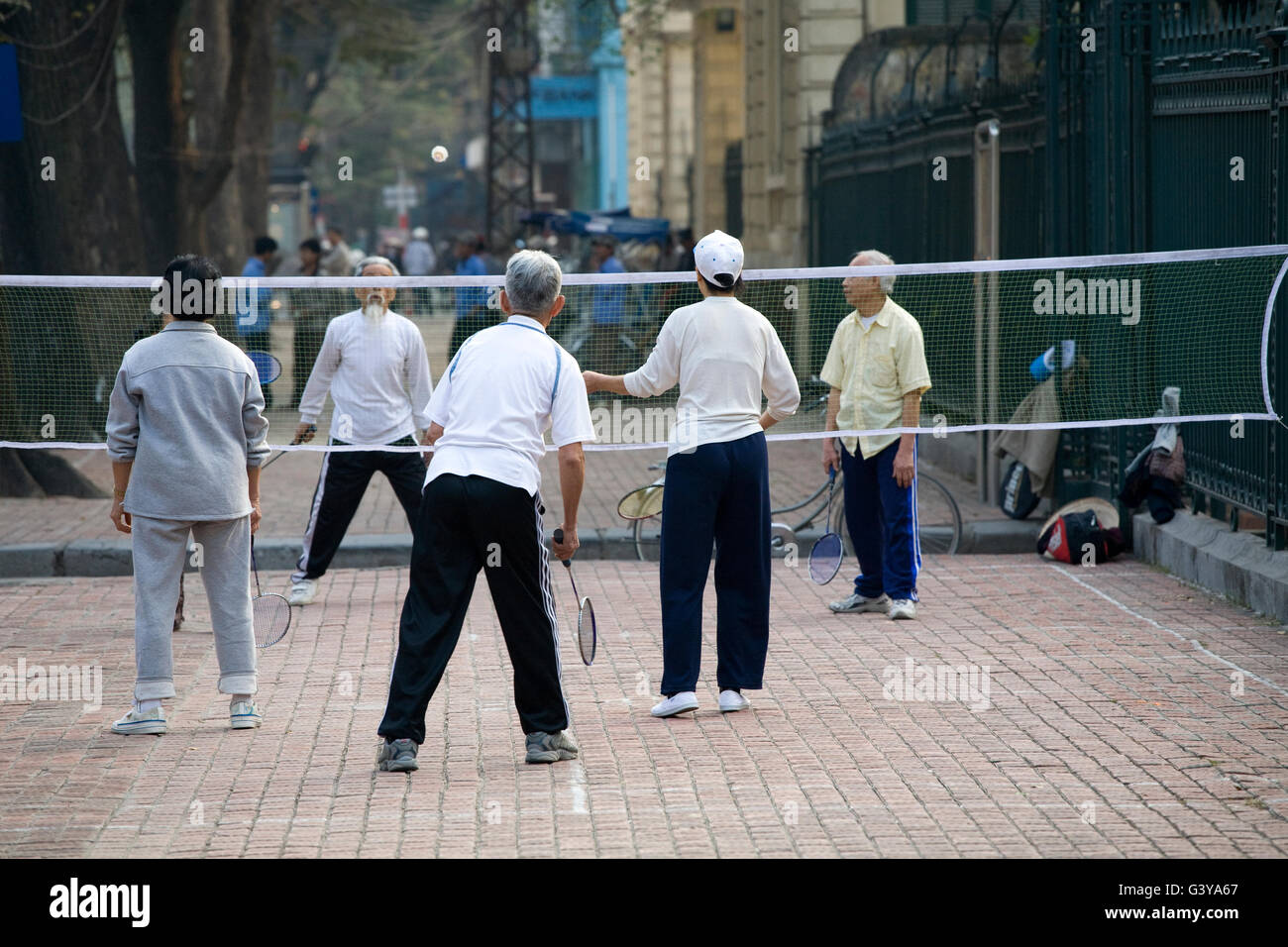 People playing badminton on the street, Hanoi, Vietnam, Southeast Asia, Asia - Stock Image