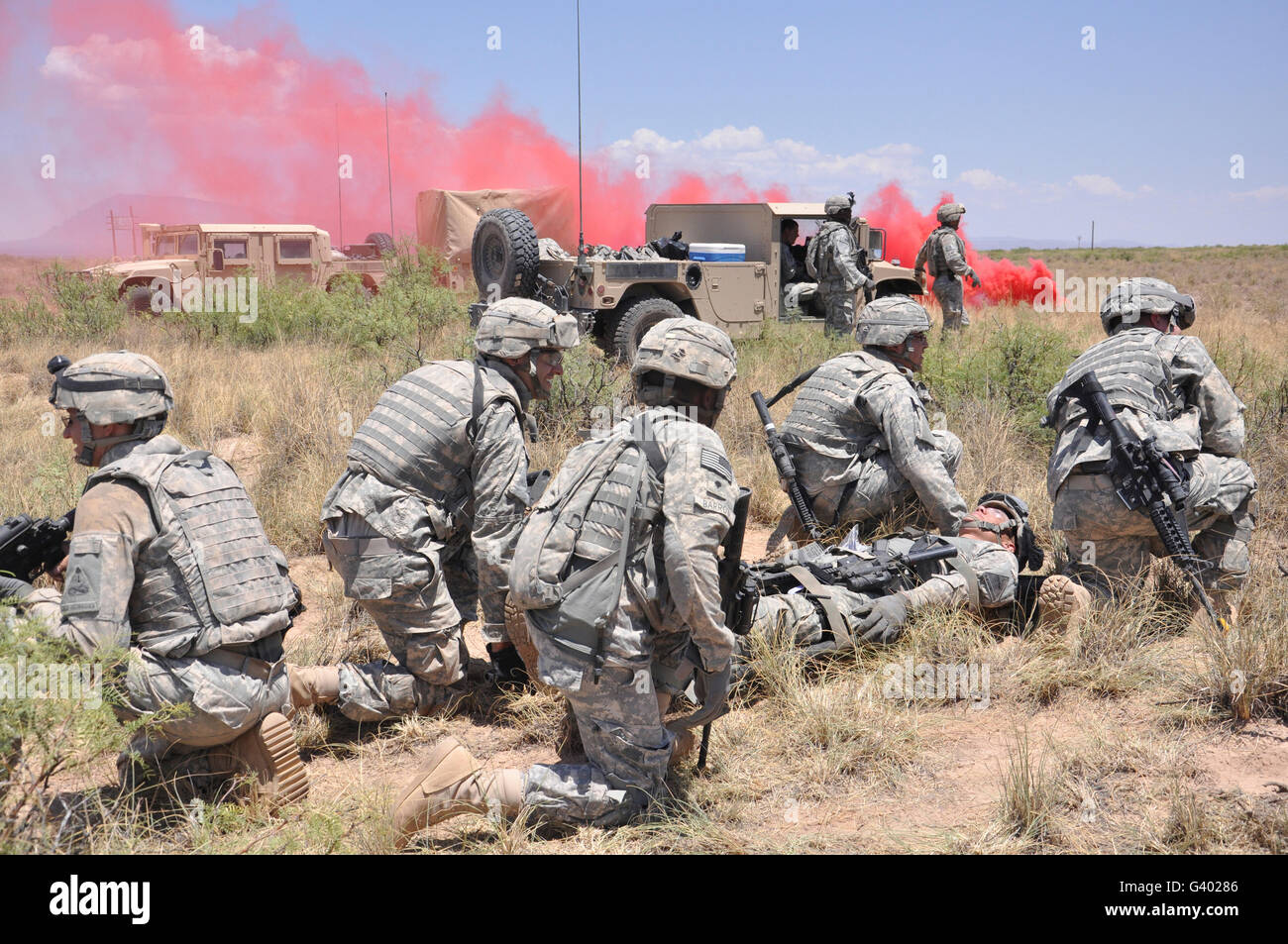 Soldiers prepare to transport a wounded soldier during a medical evacuataion. Stock Photo