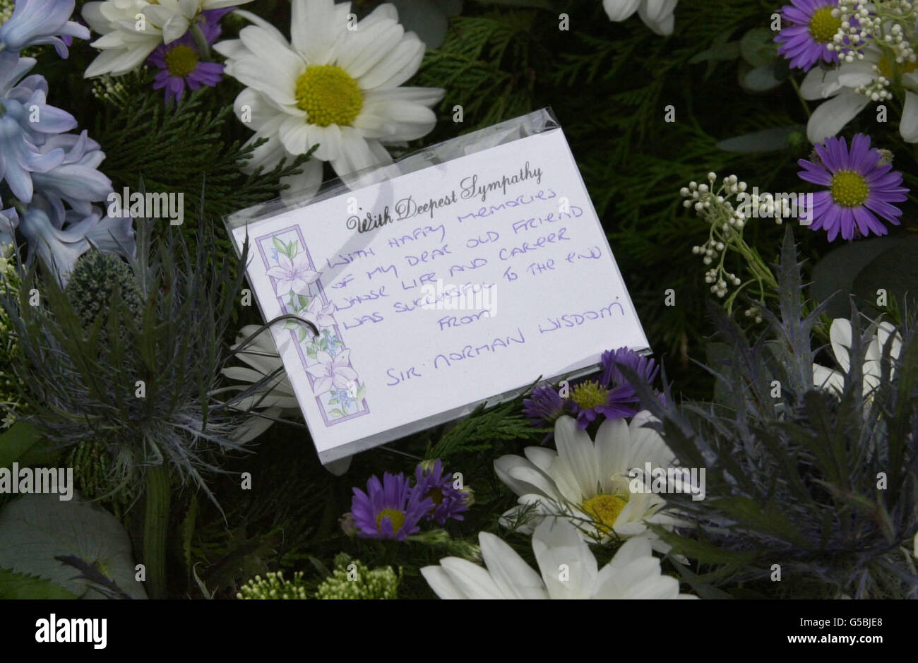 Funeral flowers card stock photos funeral flowers card stock london harry secombe funeral flowers stock image izmirmasajfo Image collections