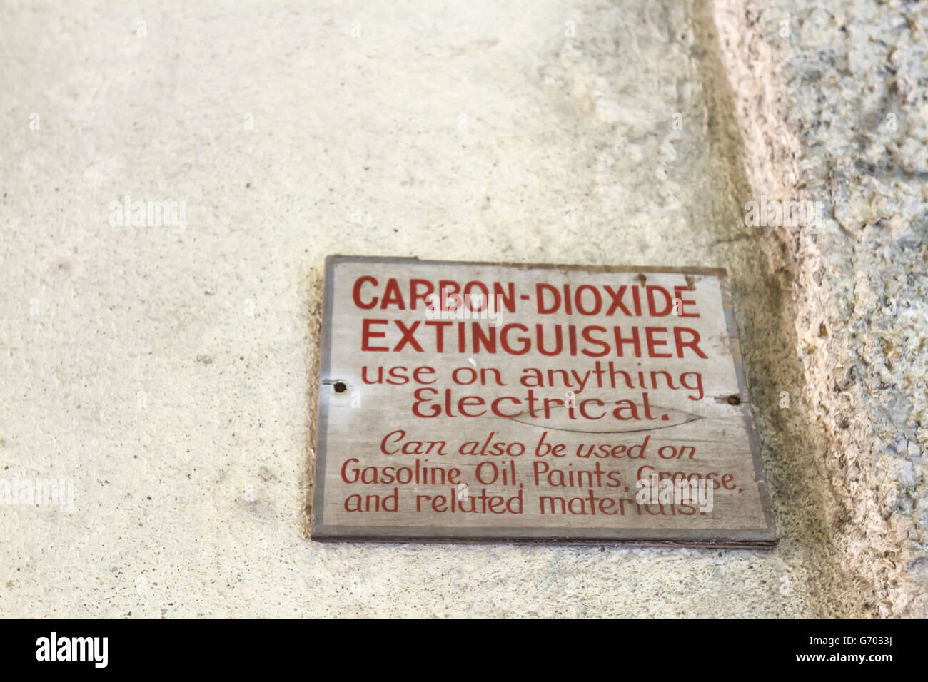 Vintage wooden carbon dioxide fire extinguisher on walls of Ellis Island. - Stock Image