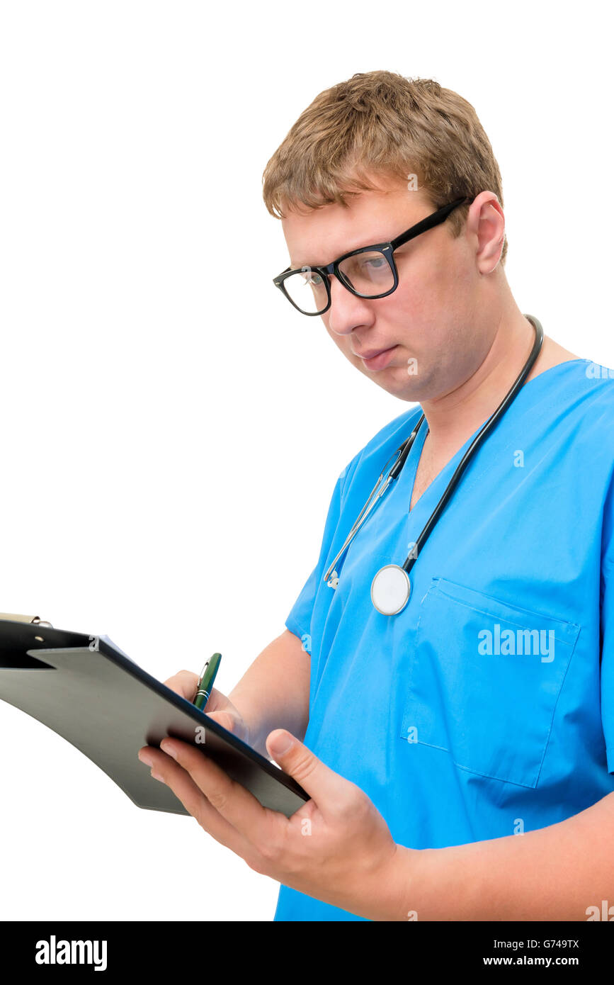 The doctor writes the results of surveys in a folder on a white background - Stock Image
