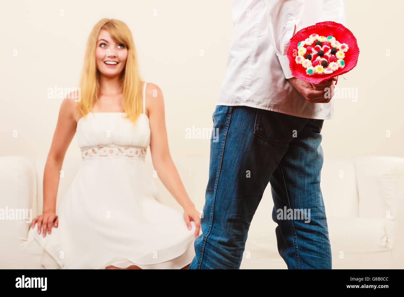 Man Holding Candy Bunch Flowers Boyfriend With Surprise Present