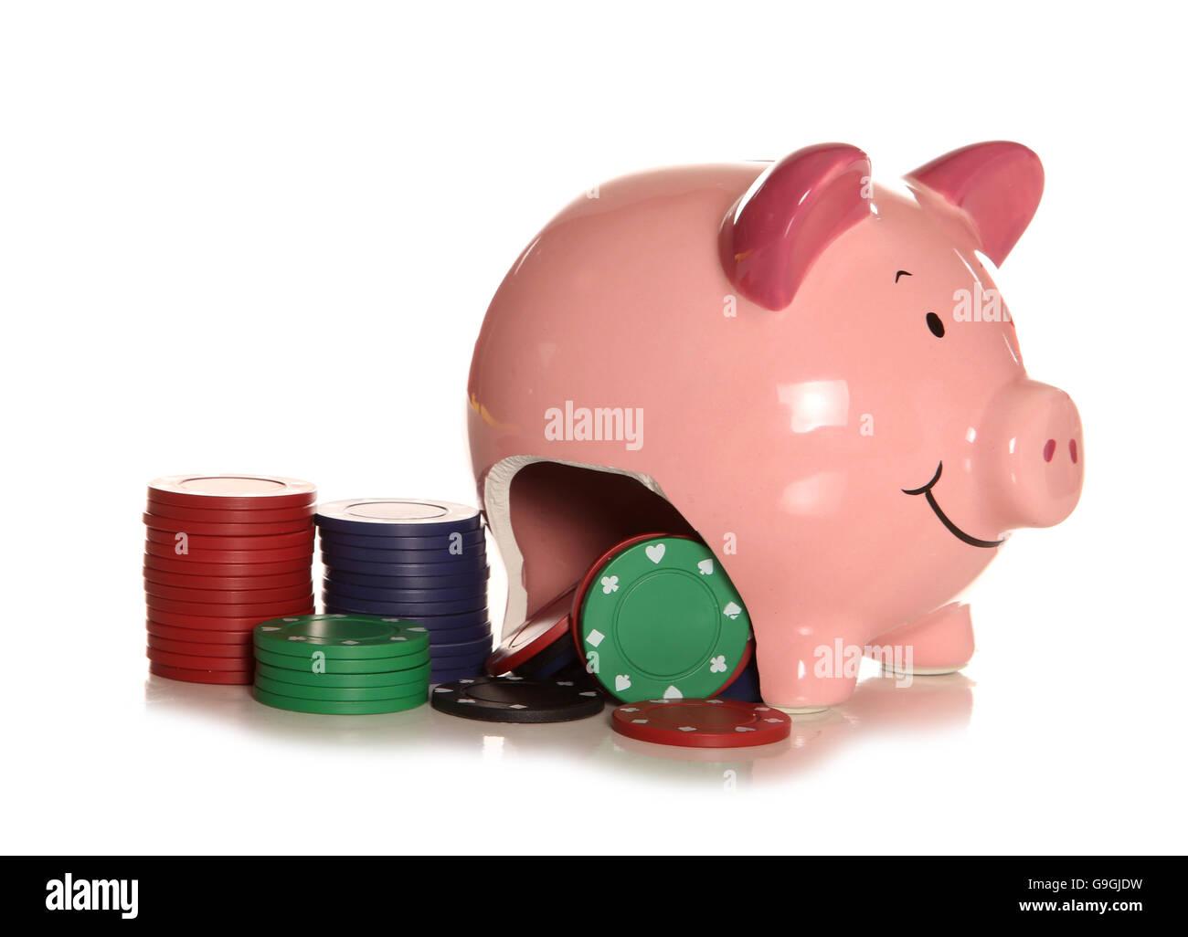 Spending your savings on gambling piggybank cutout - Stock Image
