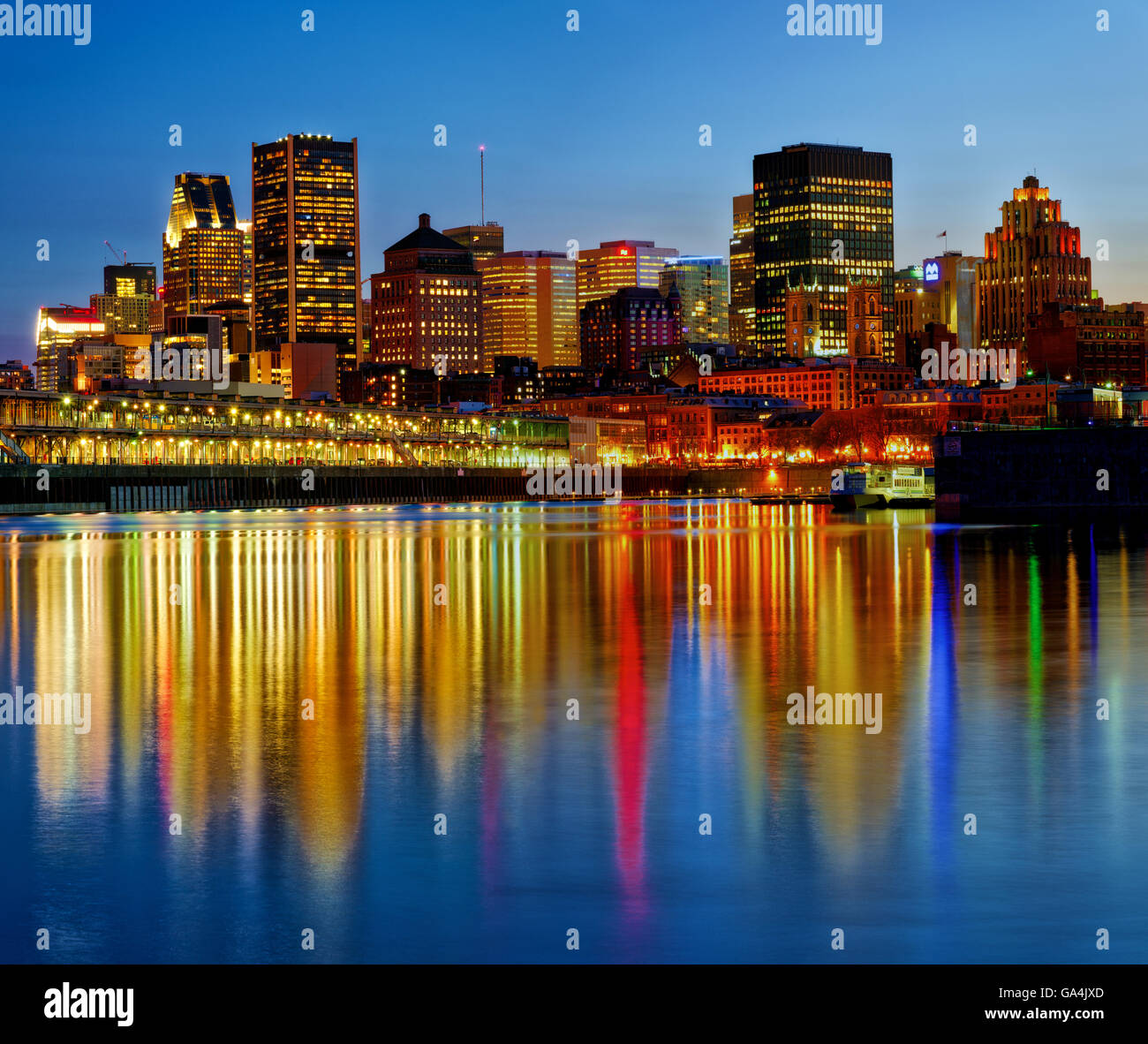 montreal-old-port-at-dusk-reflected-in-the-st-lawrence-river-GA4JXD.jpg