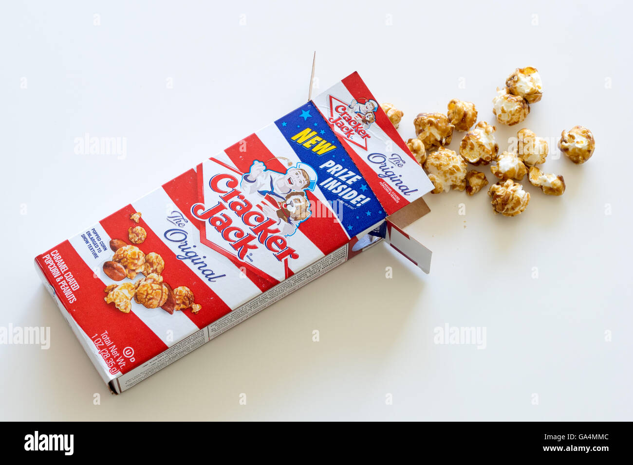 A box of Cracker Jack, an American snack consisting of molasses-flavoured caramel-coated popcorn and peanuts. Stock Photo