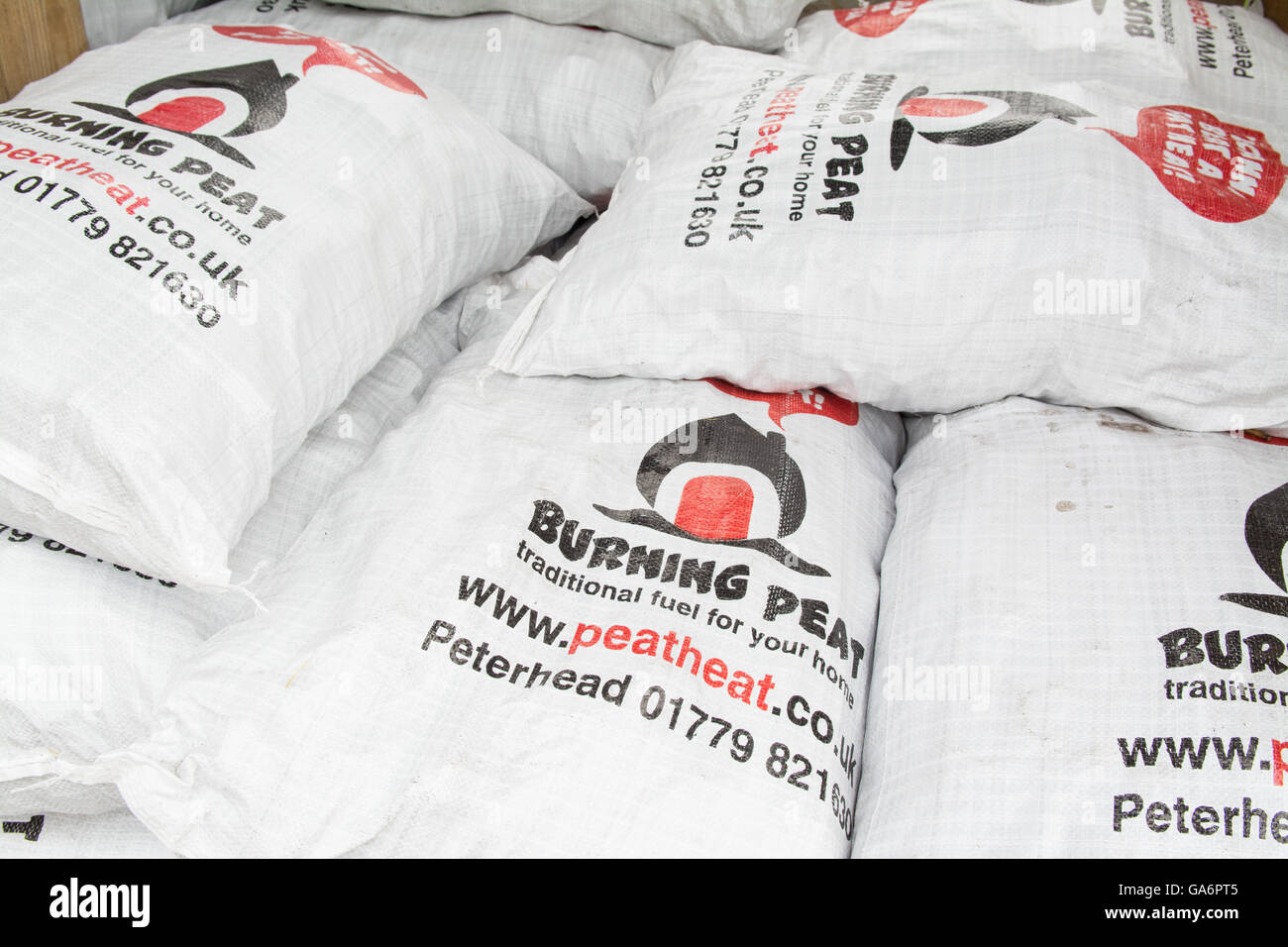 bags of Burning Peat fuel - Stock Image