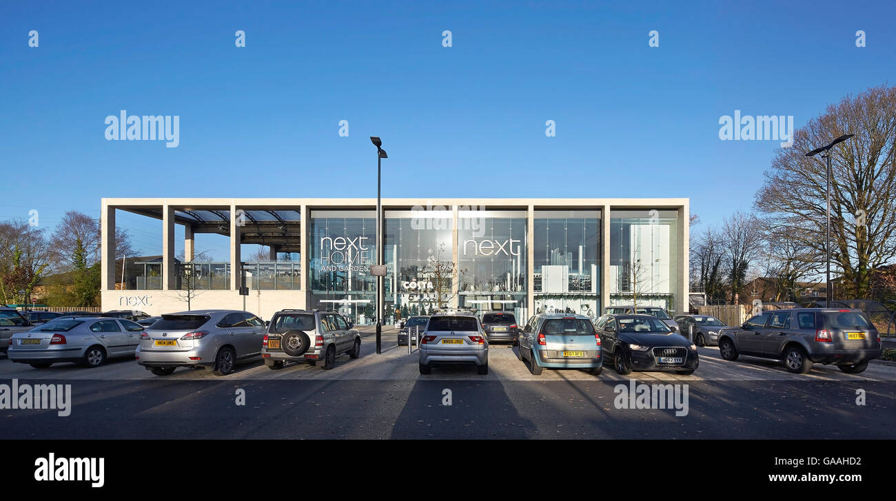 Front elevation of main entrance with full-height glazing and and car park. Next -  Home and Garden Stores, Southampton, - Stock Image