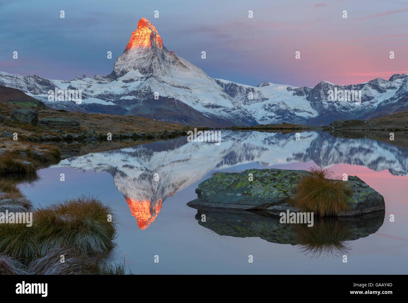 Matterhorn (4,478m) at sunrise, with reflection in Lake Stellisee, Zermatt, Switzerland, September 2012. - Stock Image
