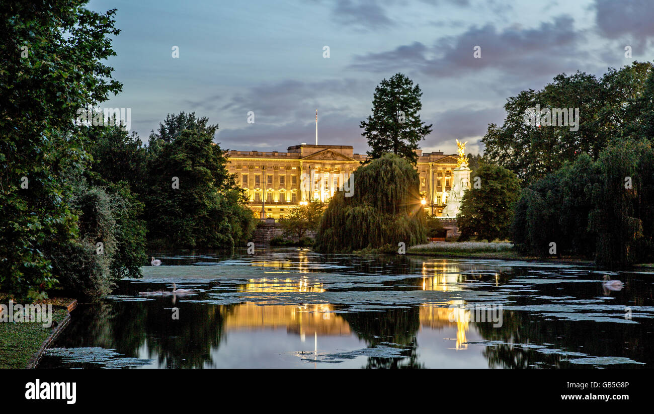 Buckingham Palace At night with Pond In St James Park London UK Stock Photo
