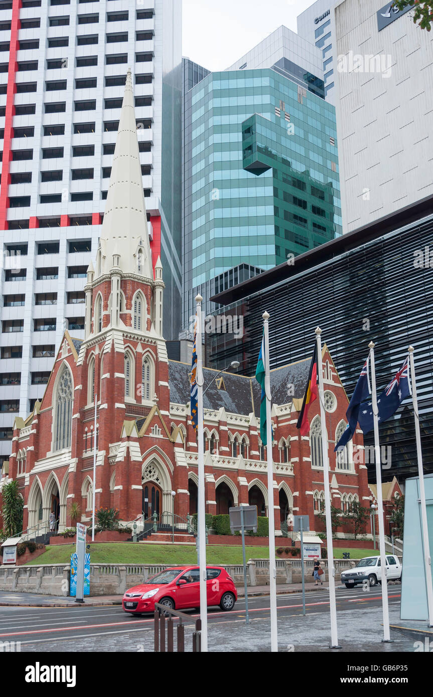 Albert Street Uniting Church with skyscrapers behind, Albert Street, Brisbane City, Brisbane, Queensland, Australia - Stock Image