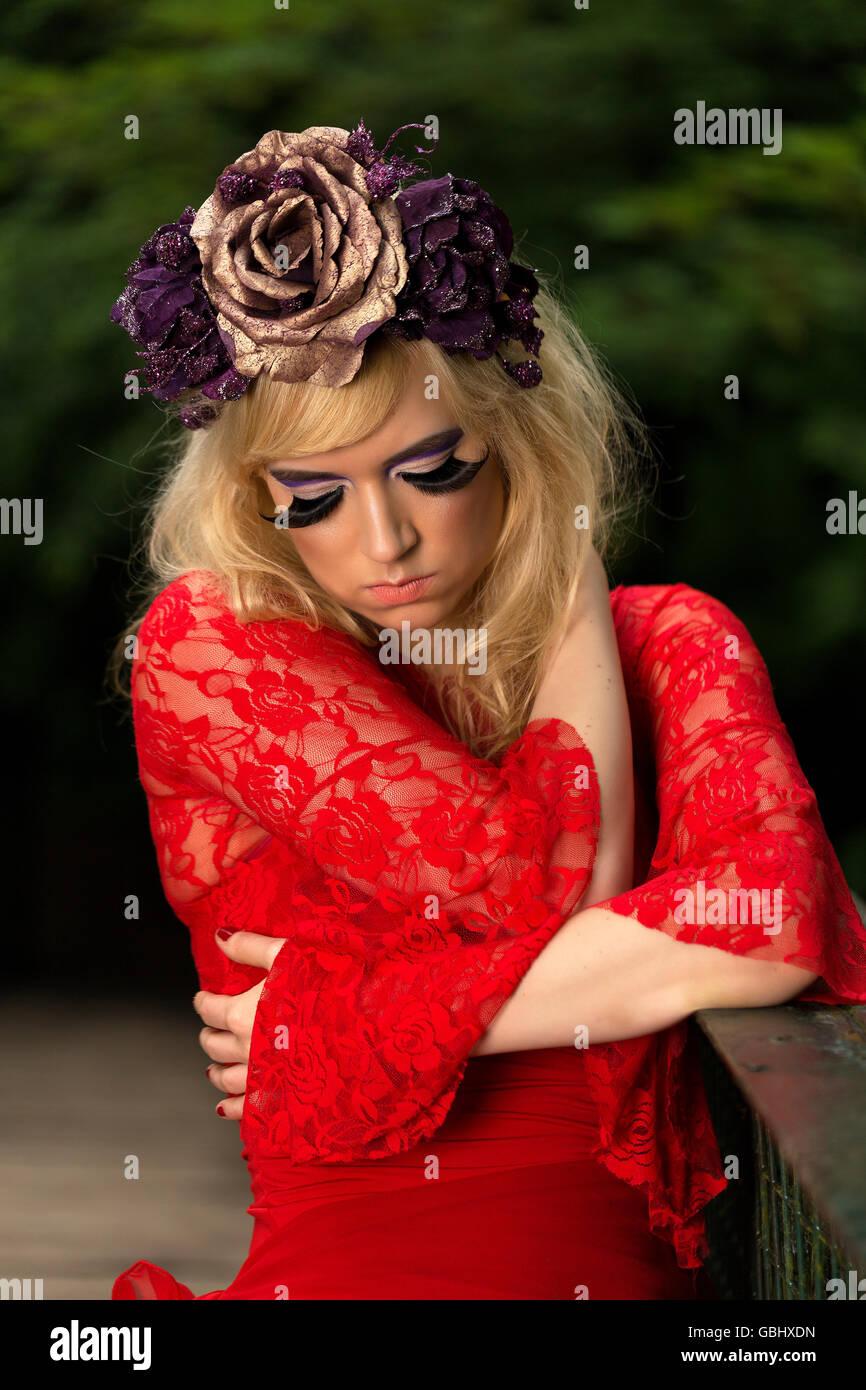 Blonde model delicate features purple flower crown winged stock blonde model delicate features purple flower crown winged eyeliner huge eyelashes red lace dress contemplative on bridge izmirmasajfo