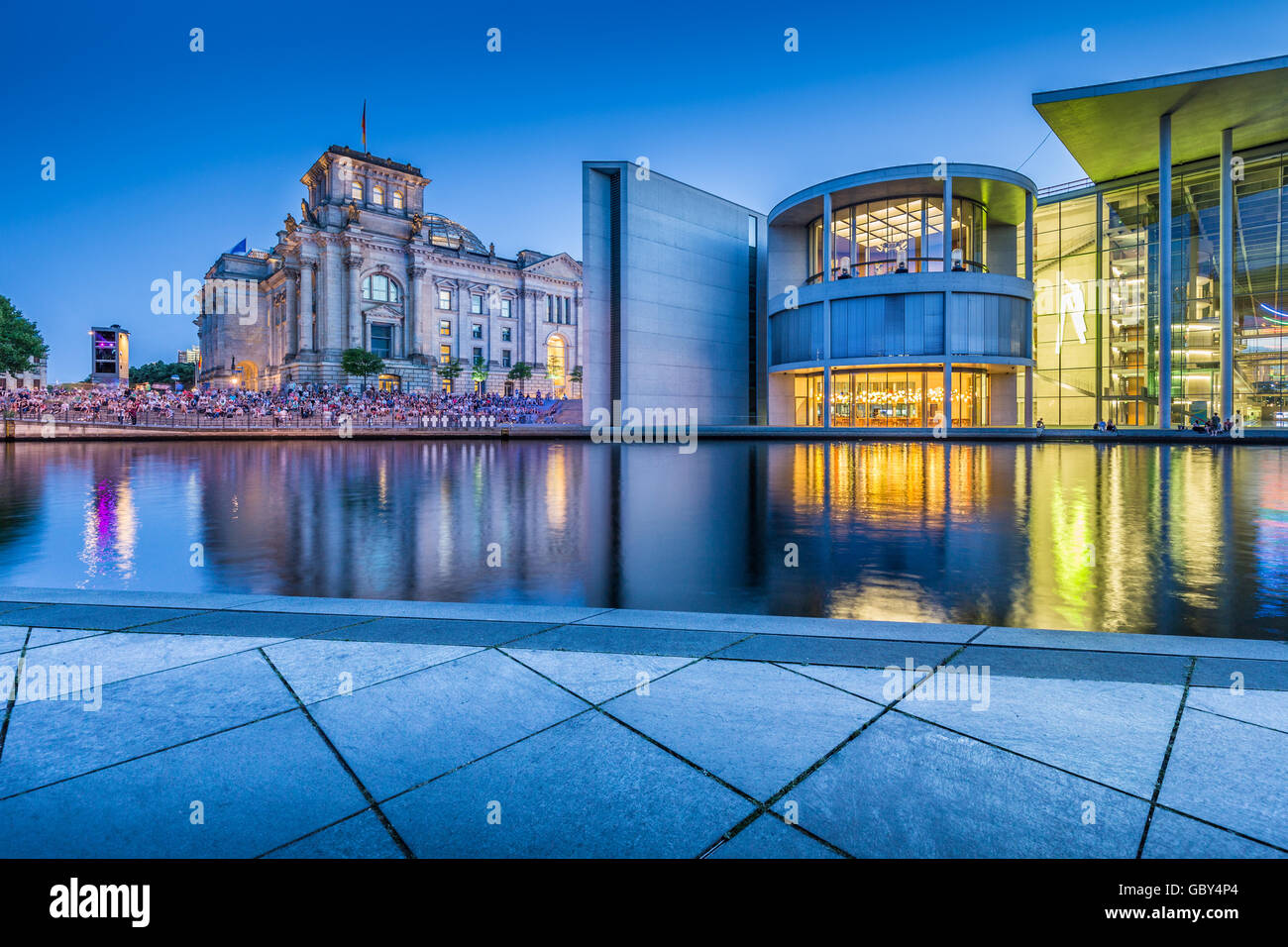 Classic view of modern Berlin government district with famous Reichstag building and Paul Lobe Haus in twilight, - Stock Image