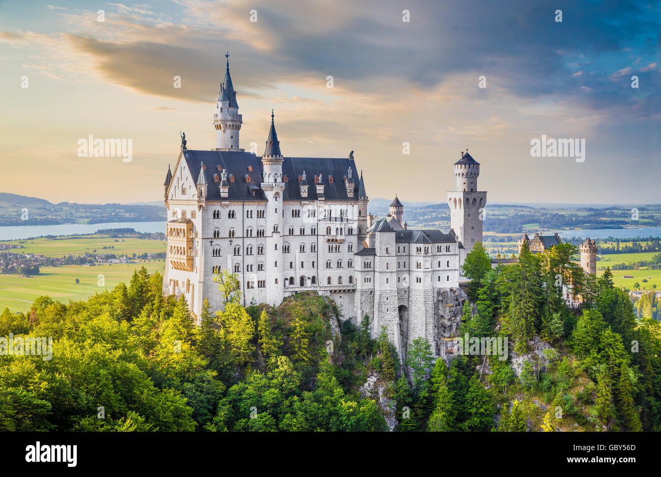Classic view of world-famous Neuschwanstein Castle, one of Europe's most visited castles, at sunset, Bavaria, - Stock Image