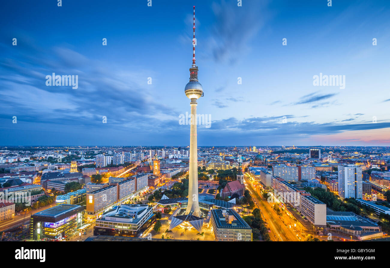 Aerial classic view of Berlin skyline with famous TV tower at Alexanderplatz and dramatic cloudscape in twilight, - Stock Image