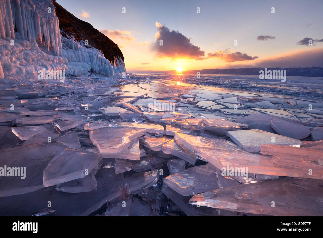 Broken ice at sunset, Baikal Lake, Olkhon Island, Siberia, Russia - Stock Image