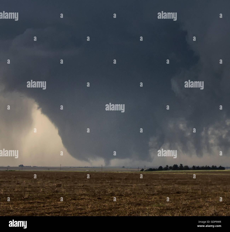 A gigantic wall cloud spins over, Dodge City, Kansas, USA - Stock Image