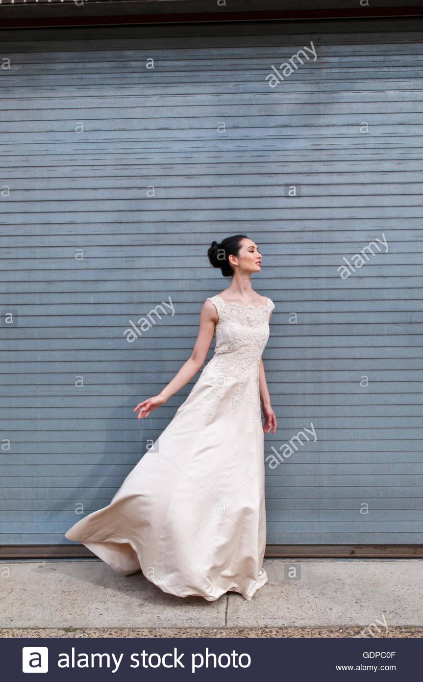 Female model in couture bridal attire - Stock Image