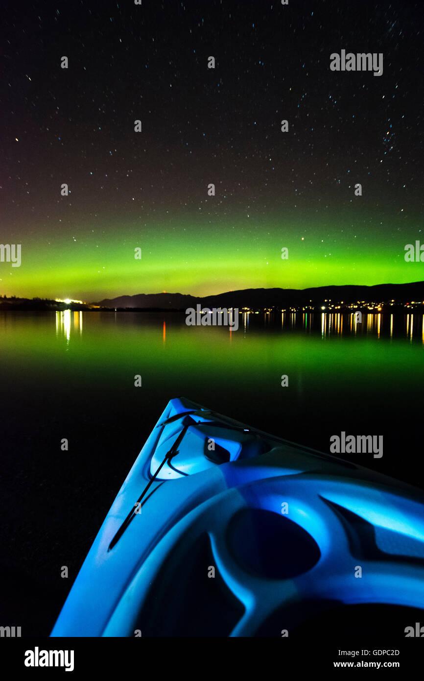 View of aurora borealis from boat on Okanagan Lake, Kickininee Provincial Park, Penticton, British Columbia, Canada - Stock Image