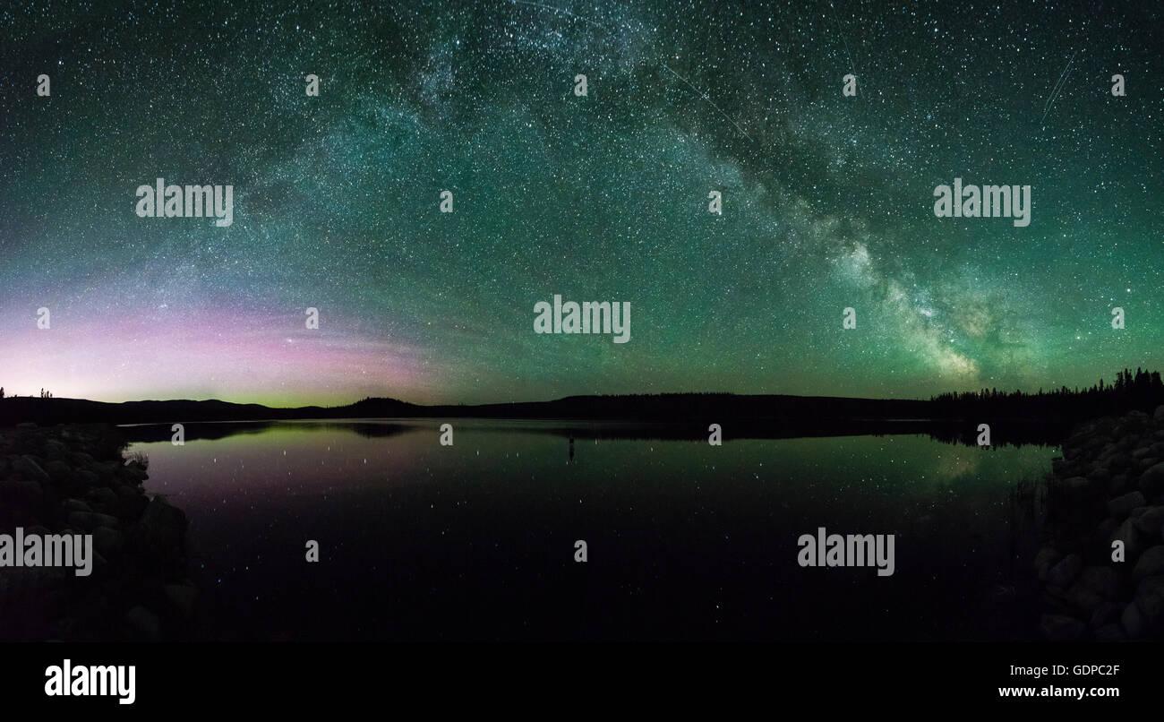 Milky way and aurora borealis over ellis reservoir, Penticton, British Columbia, Canada - Stock Image