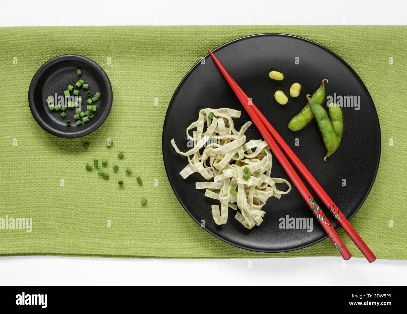 Edamame Bean Fettuccine and fresh Edamame Beans garnished with Chives - Stock Image