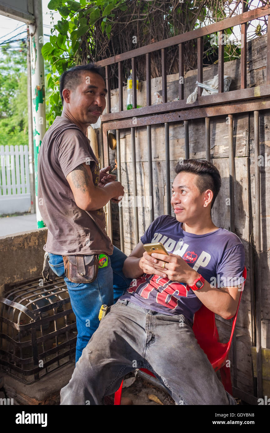 Smart phone connecting with people anywhere,modern times Chiang Mai,Thailand - Stock Image