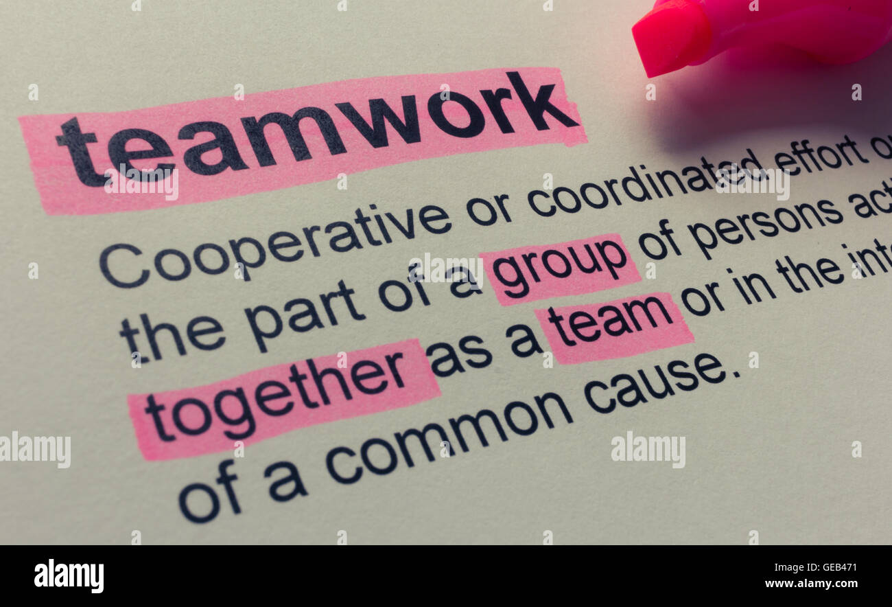 definition of teamwork, highlighted in colour stock photo: 112112197