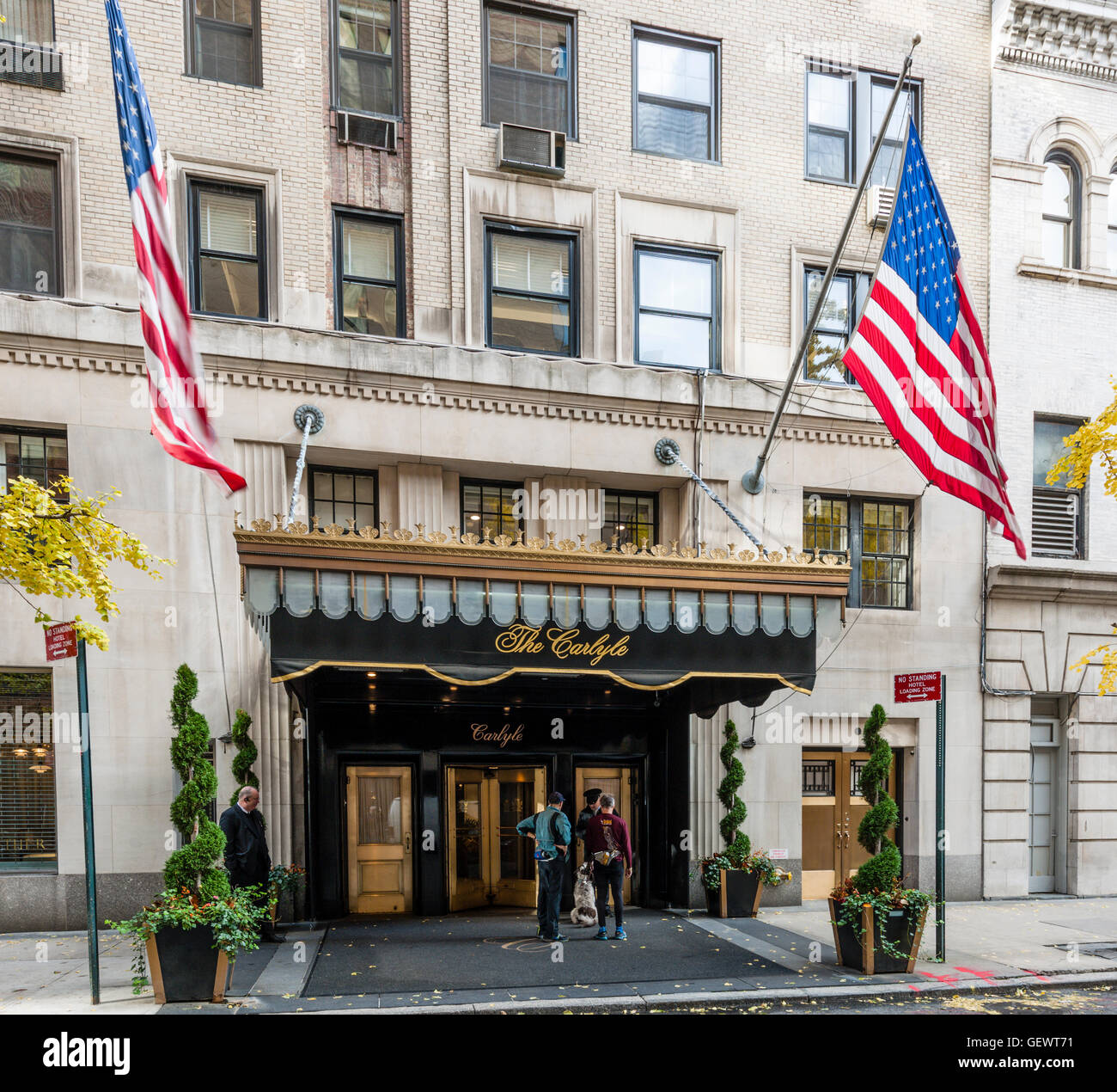 Joggers with dog outside entrance The Carlyle Hotel. Stock Photo