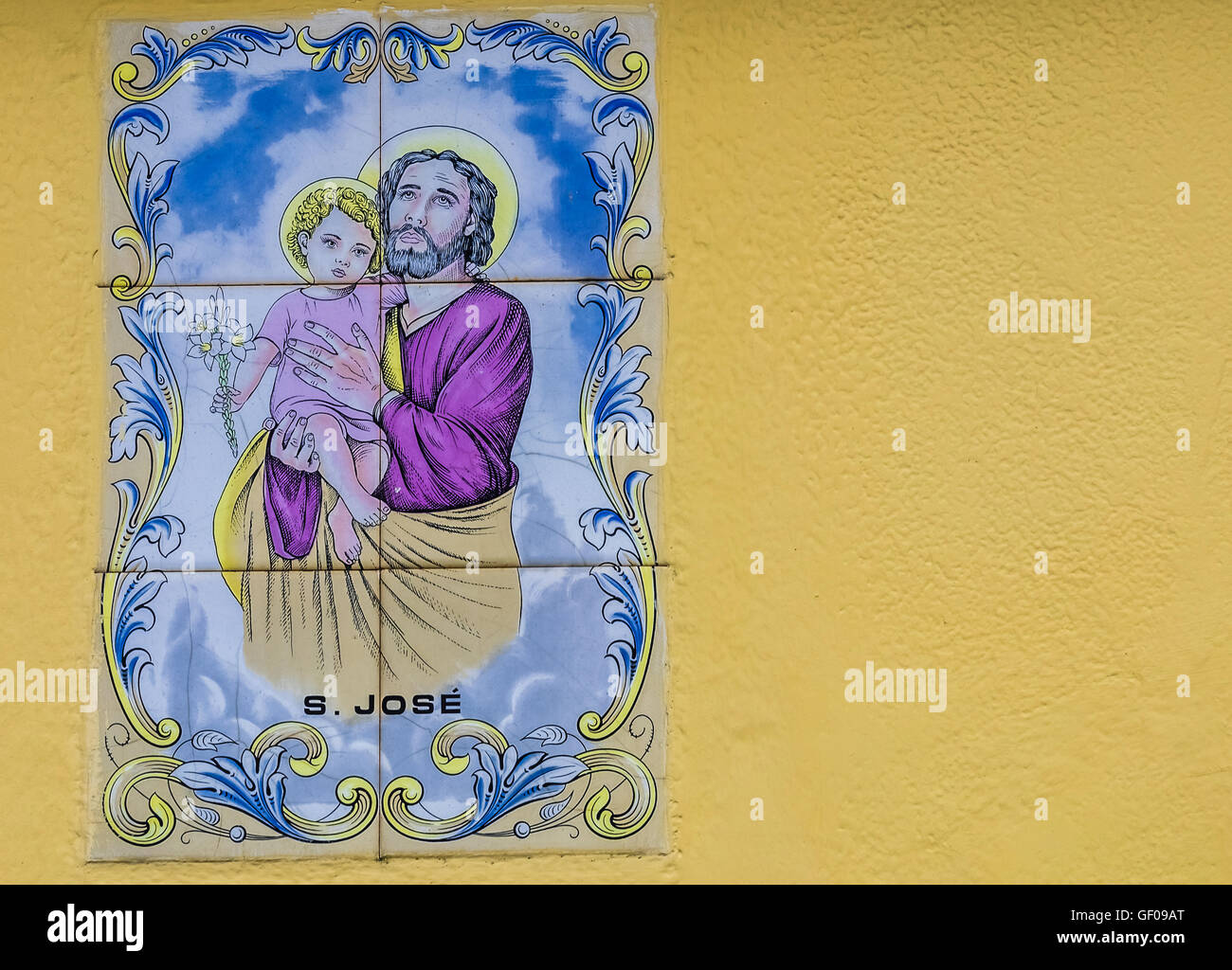Porcelain plaque depicting the Holy Family on the wall above door in ...