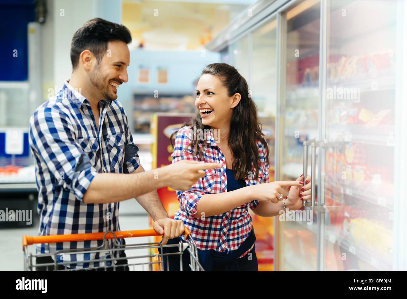 Couple shopping together  in supermarket - Stock Image