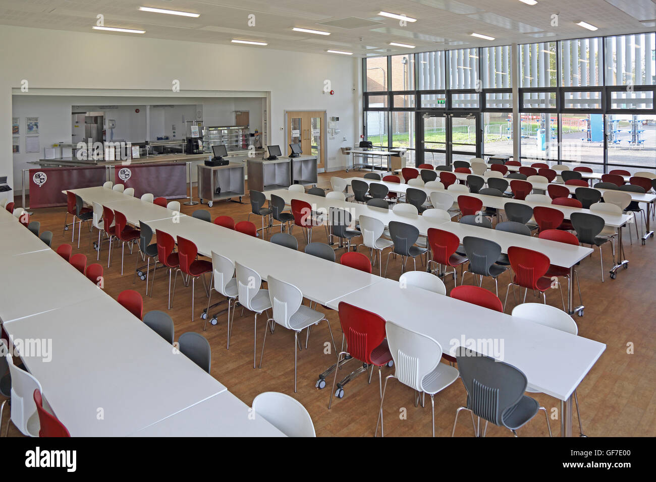 Interior view of a new school dining hall Shows tables and chairs