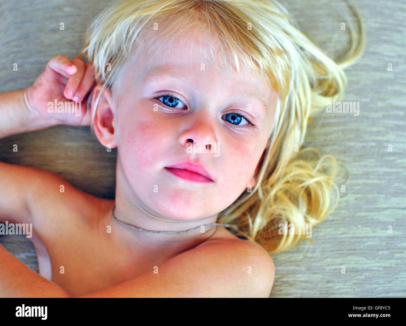 Portrait Of A Little Boy With A Long Blonde Hair Stock Photo