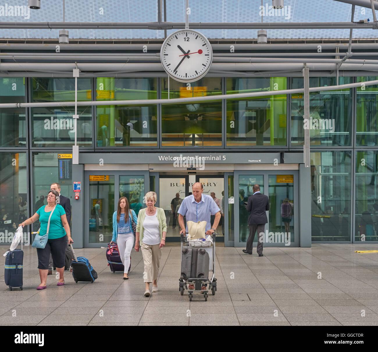 terminal 5 heathrow airport  passengers leaving terminal - Stock Image