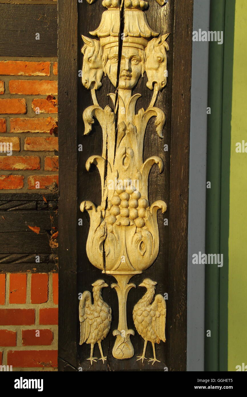 Old carvet Ornaments on a doorframe of an old German farmhouse - Stock Image