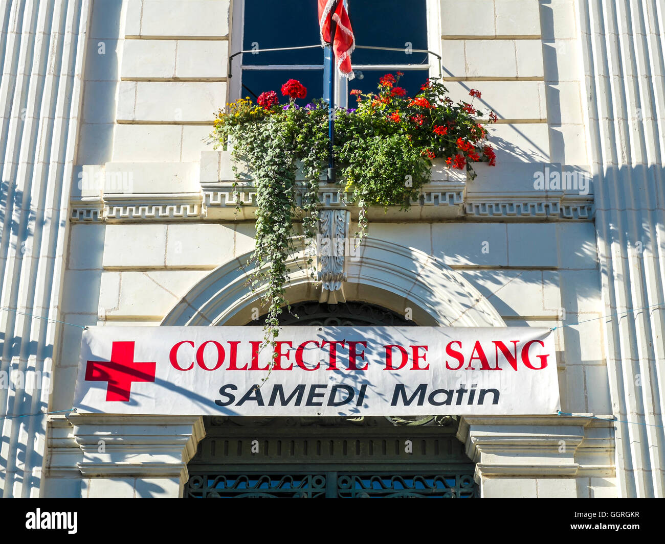 """Blood Collection"" / ""Collect de Sang"" banner on town hall - France. - Stock Image"