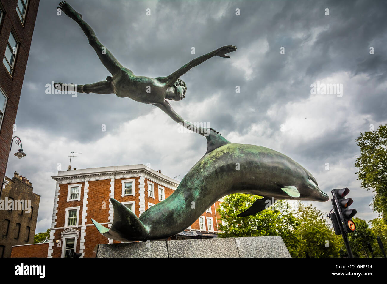London, England, UK: Boy with a Dolphin by David Wynne outside the Mercedes-Benz showroom, Chelsea, London, UK Stock Photo