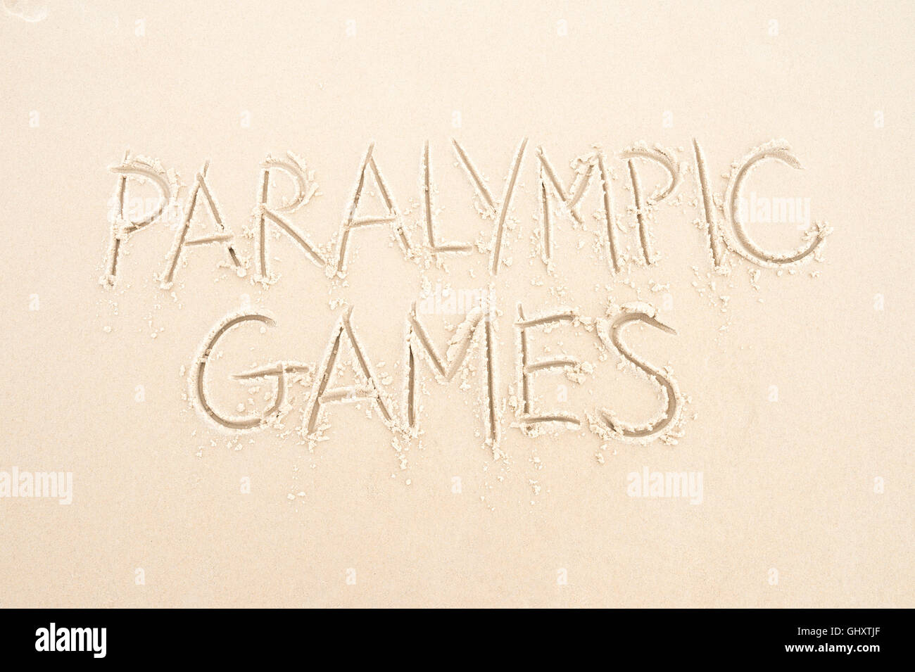 RIO DE JANEIRO - MARCH 20, 2016: Paralympic Games message written in the sand on Ipanema Beach. - Stock Image