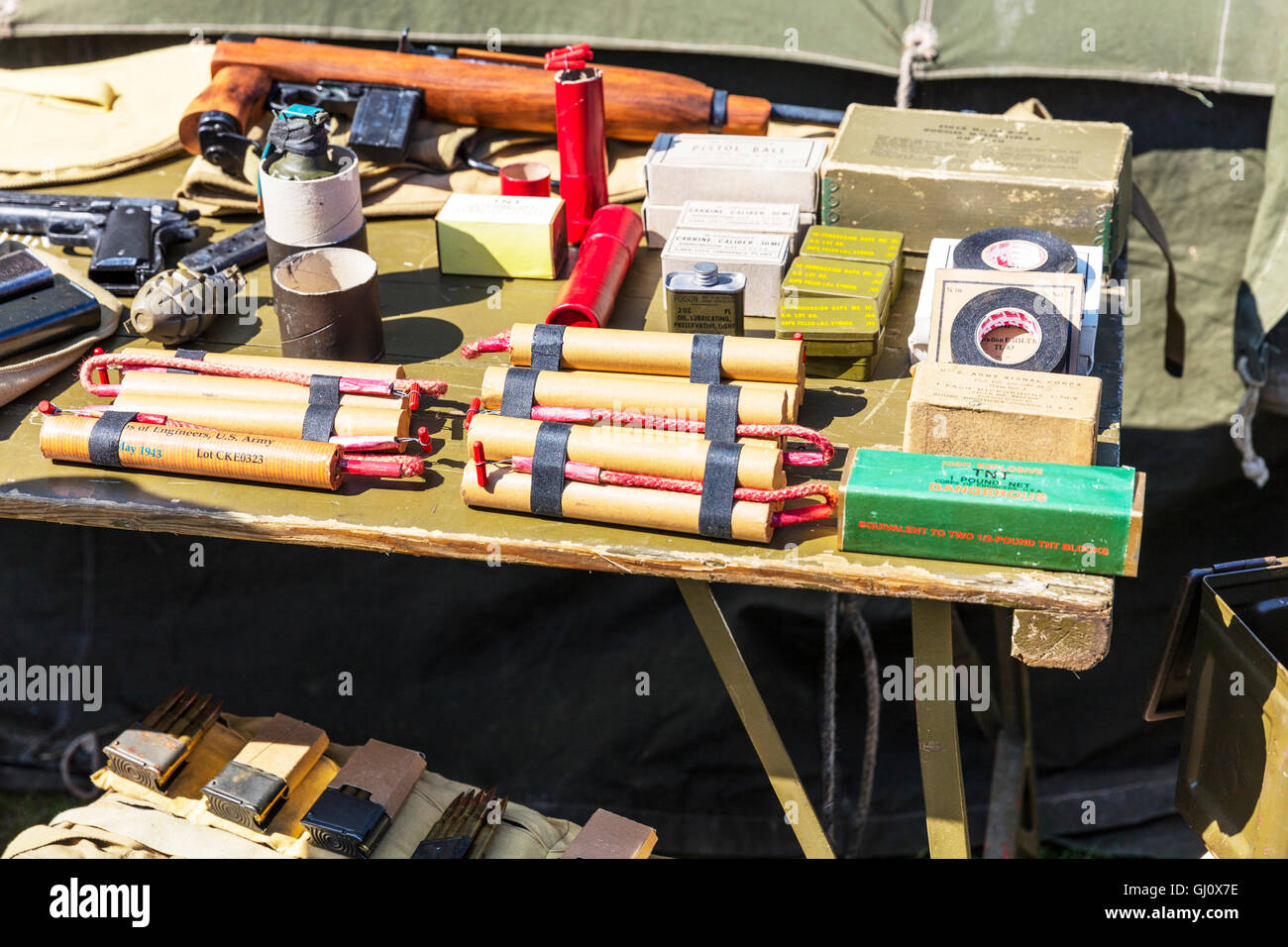 Dynamite tnt T.N.T. explosives explosive sticks stick fuse grenade grenades tape detonation devices war UK England - Stock Image