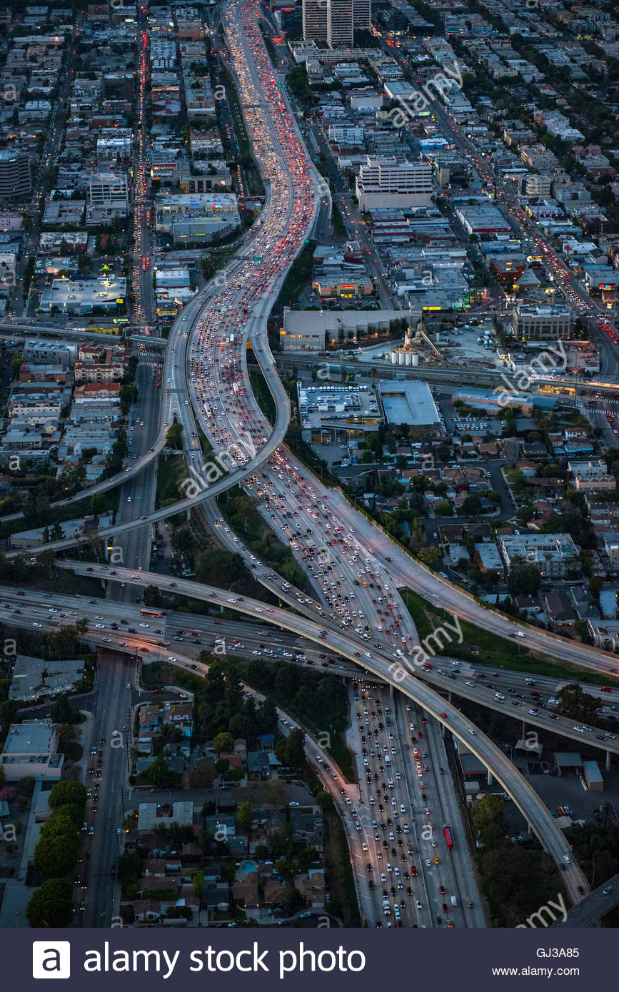 Aerial view of rush hour traffic on highway and flyover at dusk, Los Angeles, California, USA - Stock Image