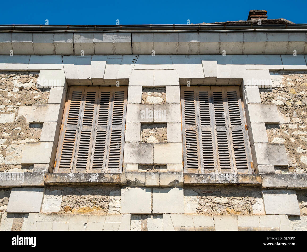 Old window shutters in terrace of stone houses - France. - Stock Image
