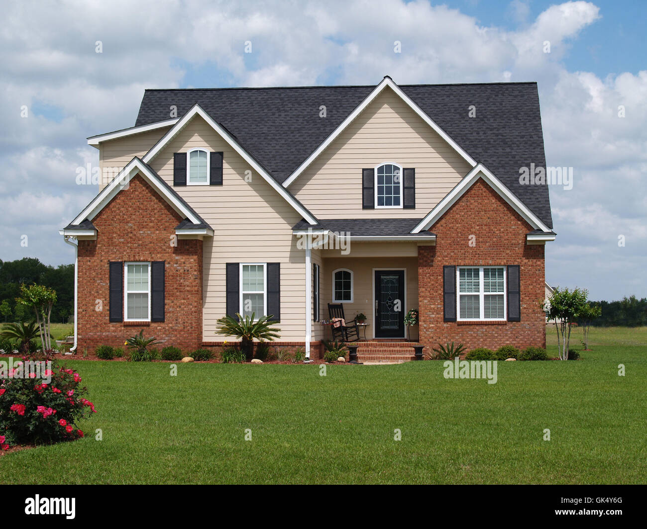Shutters brick building facade stock photos shutters for Brick house construction