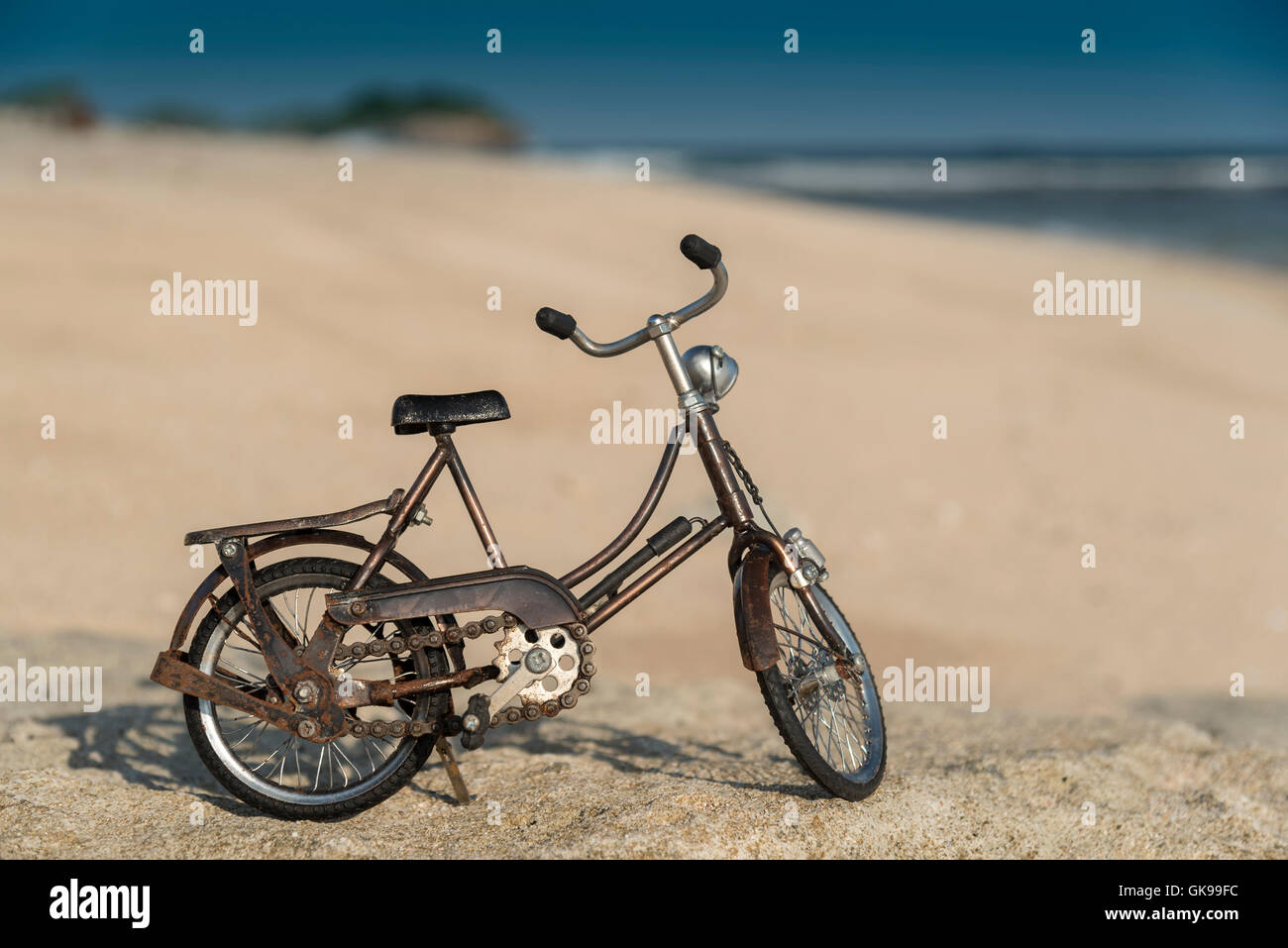 Small model bicycle on the beach - Stock Image