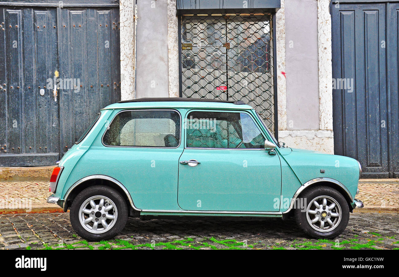 LISBON - DECEMBER 25, 2012: Old fashioned light blue Mini in the street of Lisbon on December 25, 2012. - Stock Image