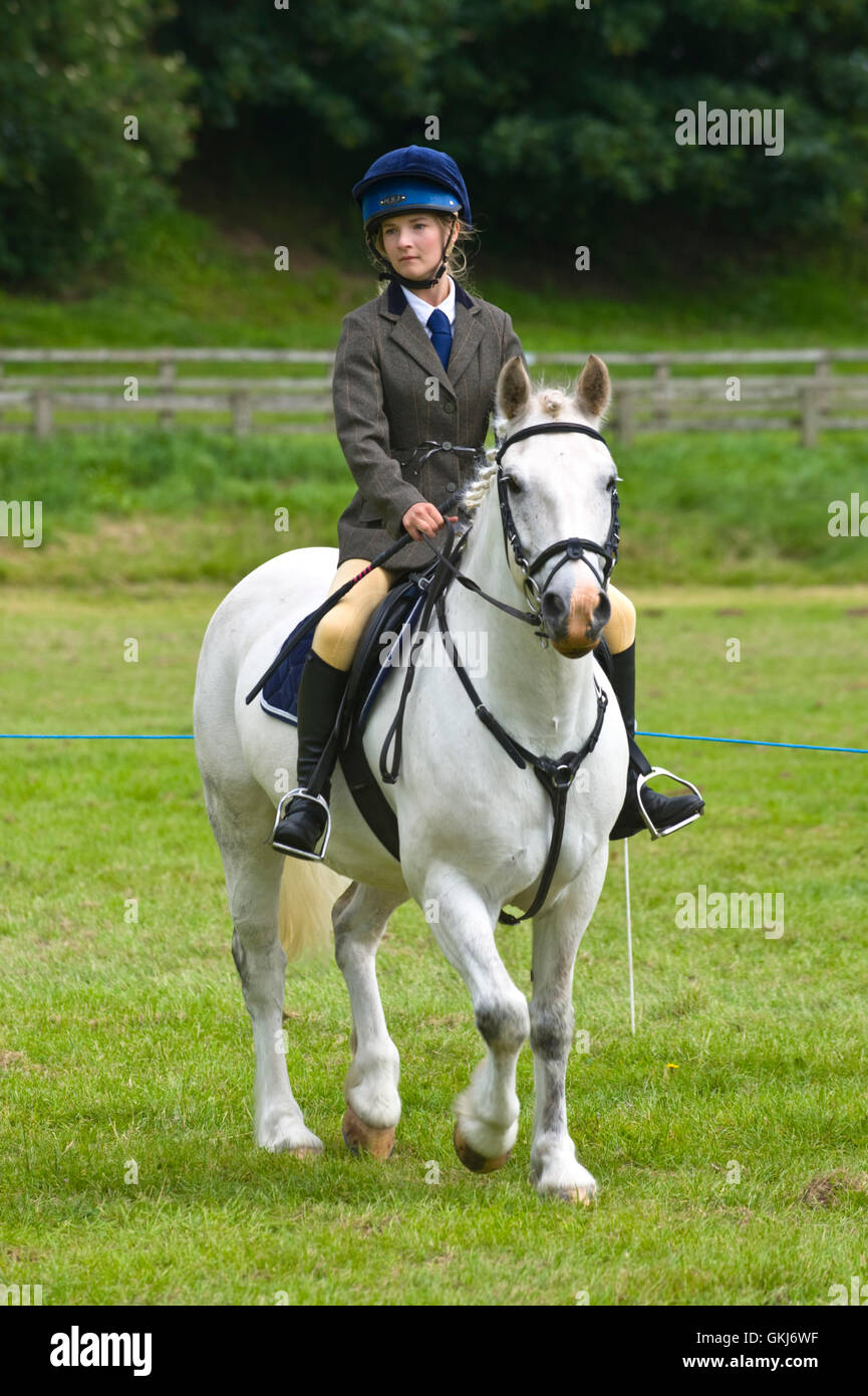 Young girl competing on her pony at Golden Valley Pony Club, Baskerville Hall, Clyro, Powys, Wales, UK - Stock Image