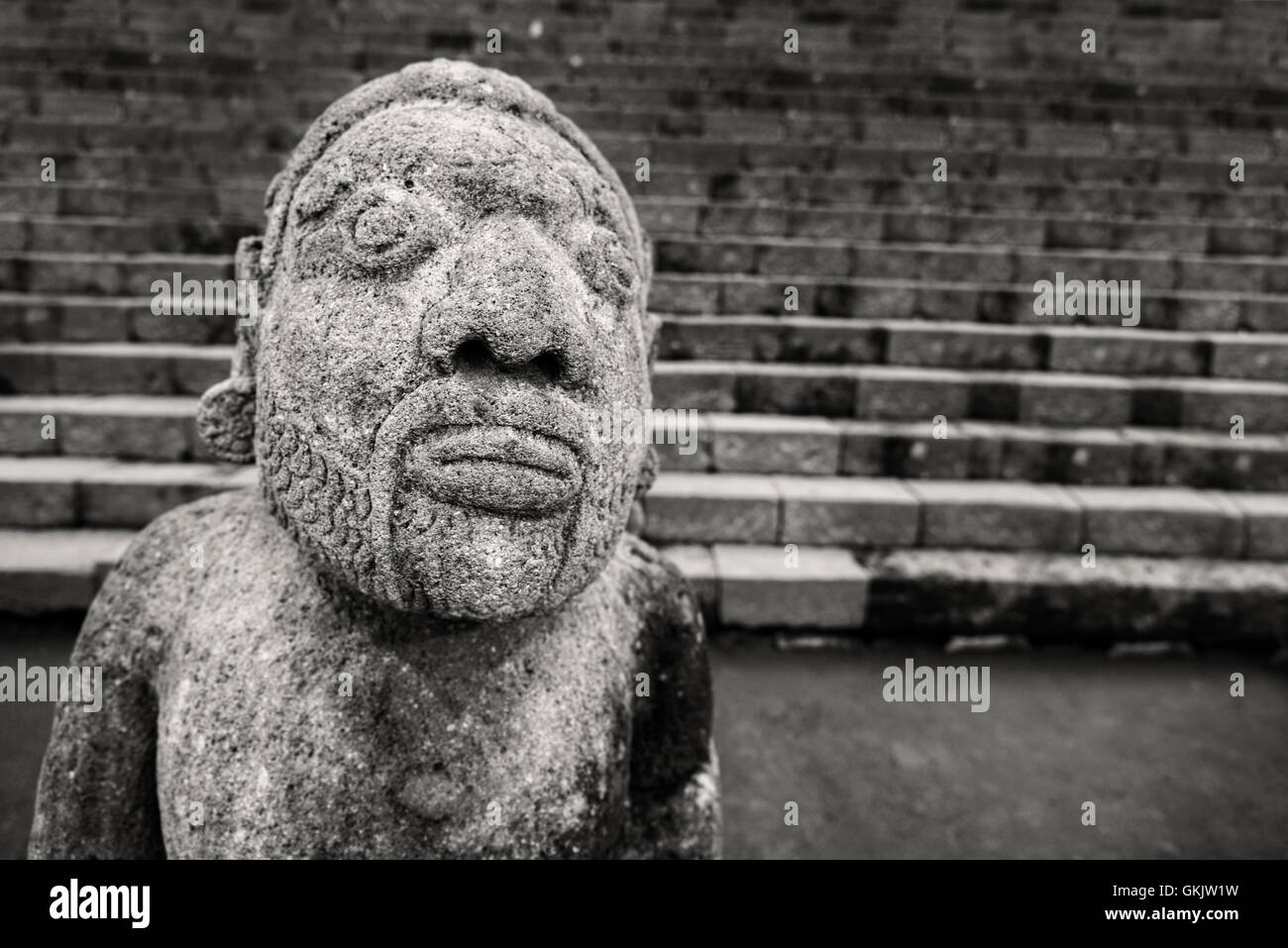Stone sculpture of man from hindu temple Cetho, Jawa, Indonesia - Stock Image